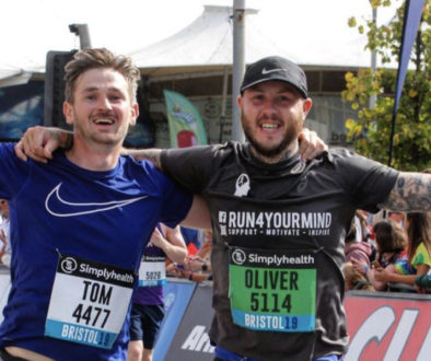 Tom and Oly at the finish line of the 2019 Bristol Half Marathon