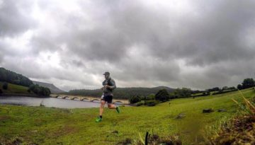 Oly running with Ladybower reservoir behind