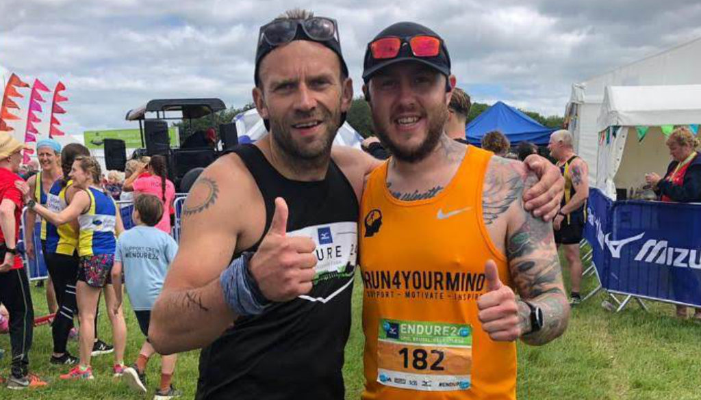 Oly with thumbs up in orange running vest after Endure24