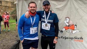 Oly & Dan with medals after the 'It's Grim Up North Running' half marathon